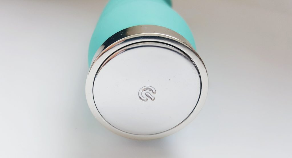 Close Up of the Large Silver Button at the Base of the VeDO INU Super Plus Vibrator