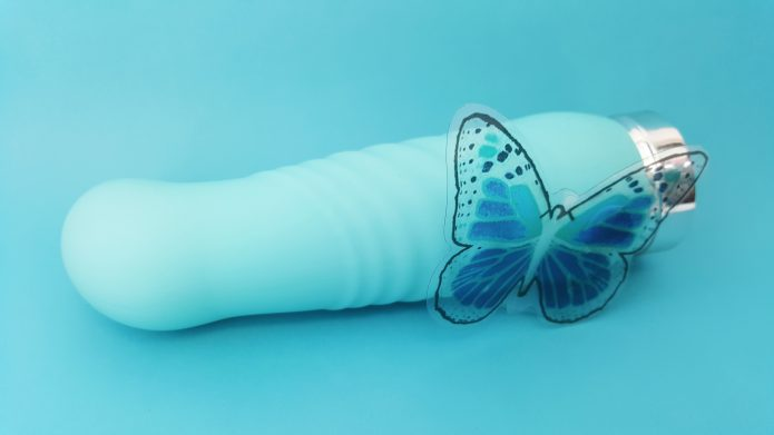 VeDO INU Super Plus Vibrator on Blue Background with Butterfly