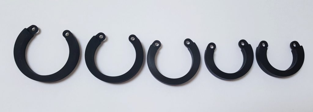 Image of the 5 Black HoD600 Silicone Rings, demonstrating their various sizes.