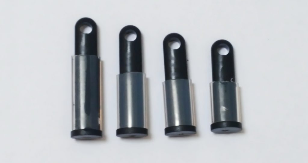 Image of the 4 Black HoD600 Spacers, demonstrating their various lengths.