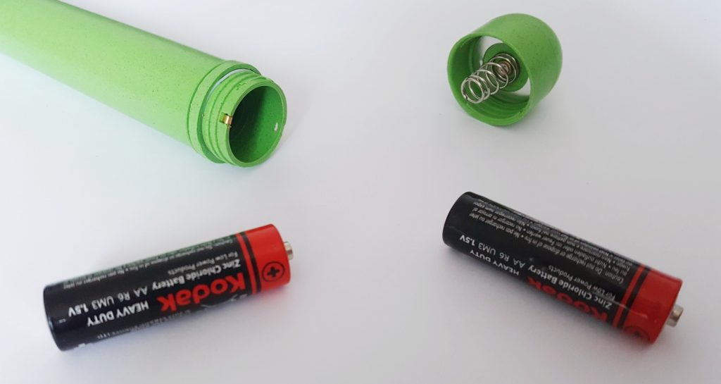 Photo of the Gaia Eco Biodegradable Vibrator Battery Compartment. Image shows Gaia unscrewed, with 2 AA batteries next to it.