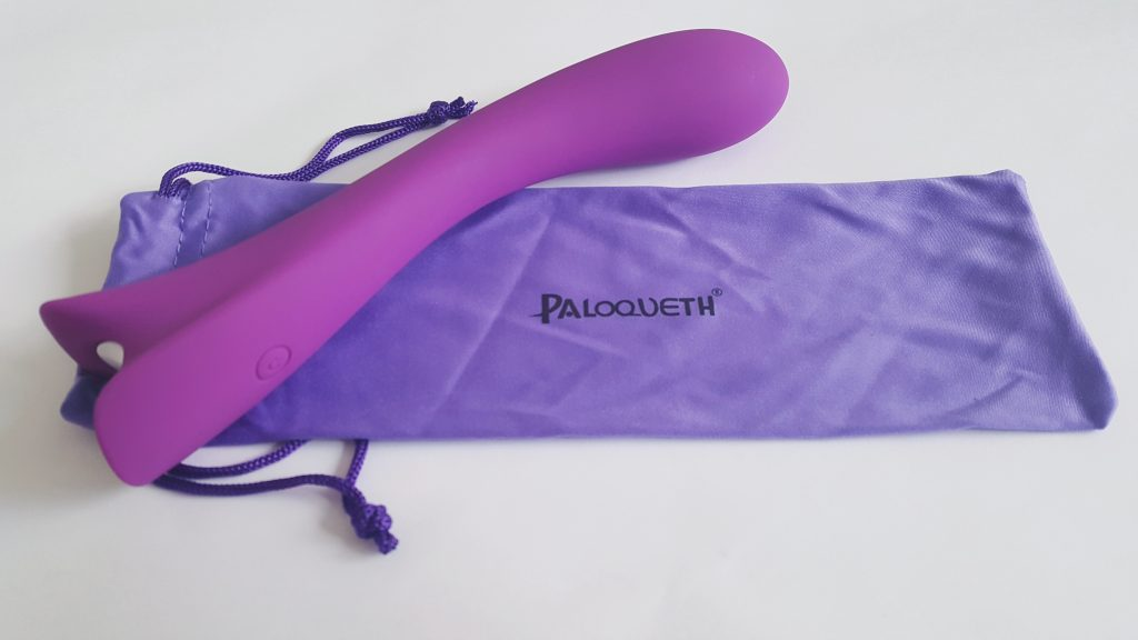 Photo of the Paloqueth G Spot Vibrator, on top of its purple satin Storage Pouch