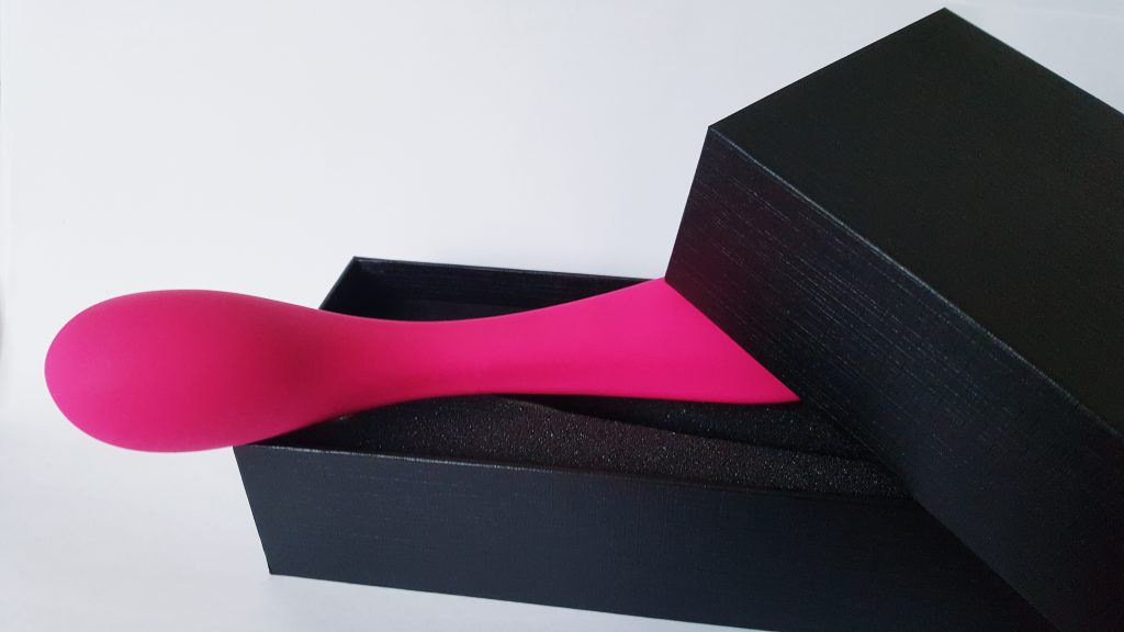 Image of the Naughty Passion Silicone G-Spot Curve Vibrator Packaging. Shows the vibrator peeking out of the black rectangular box.