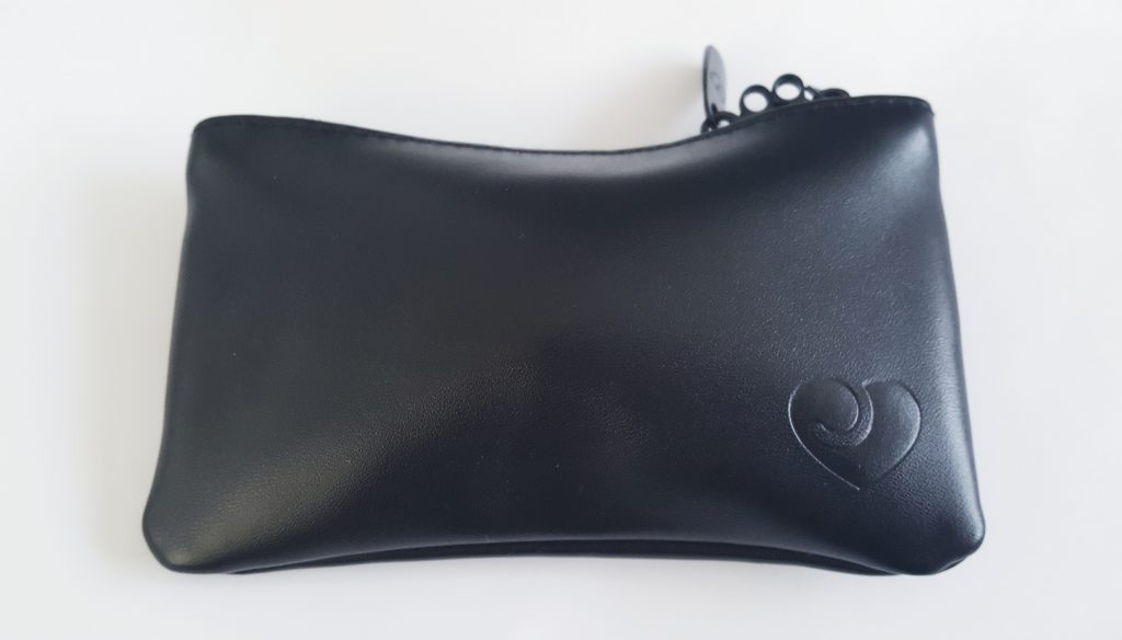 Image of the black Desire Luxury Ribbed Clitoral Vibrator Storage Pouch, with lovehoney logo in bottom right corner of pouch.
