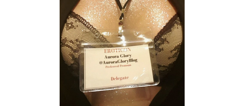 Photo of glittery cleavage, whilst wearing Eroticon 2018 badge