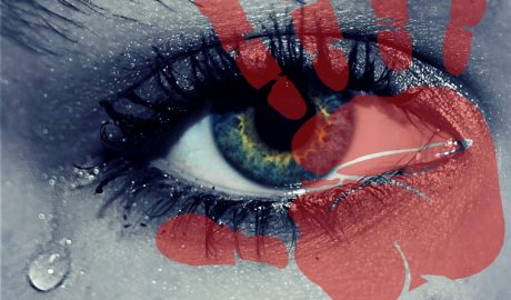 Feature image. Close up of eye with tear coming out of corner. Red handprint over image